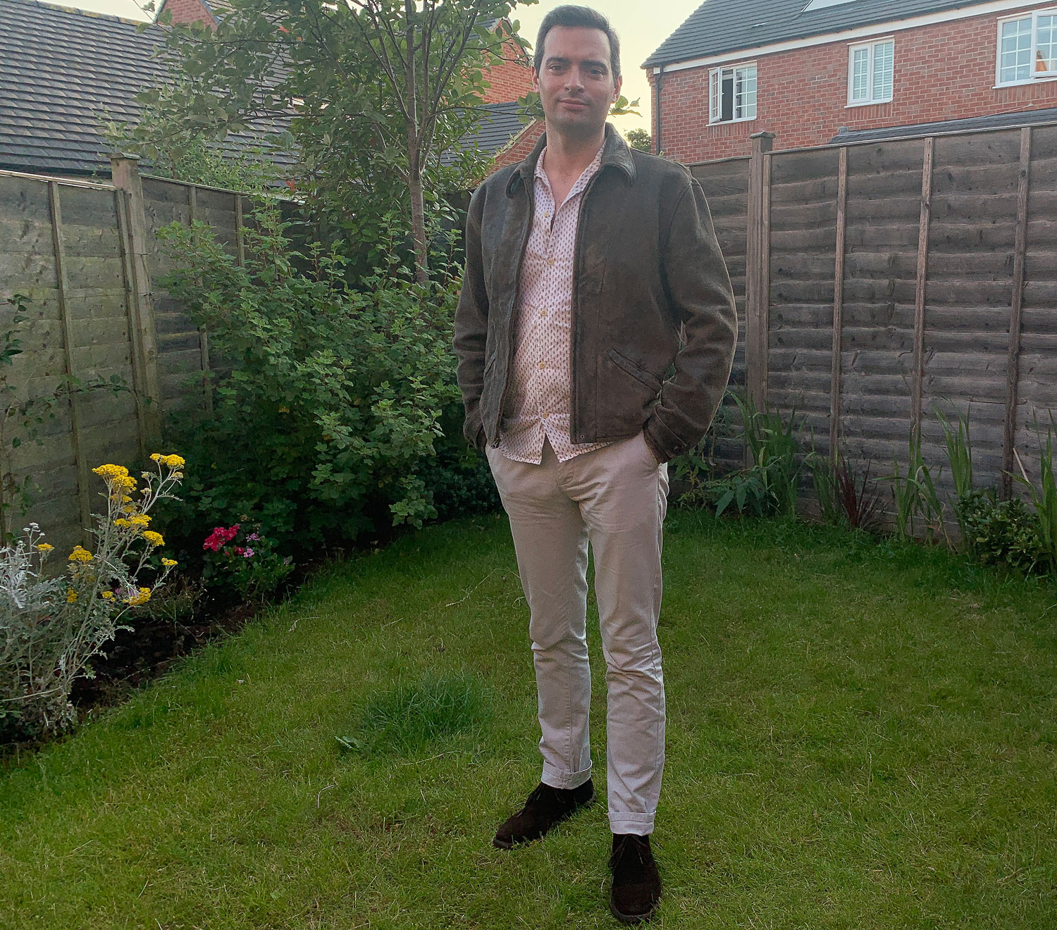 Daniel Gaster wearing the Leather Jacket from Skyfall in his garden