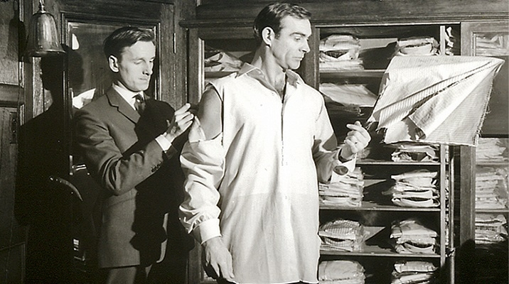 Sean Connery getting measured by Michael Fish