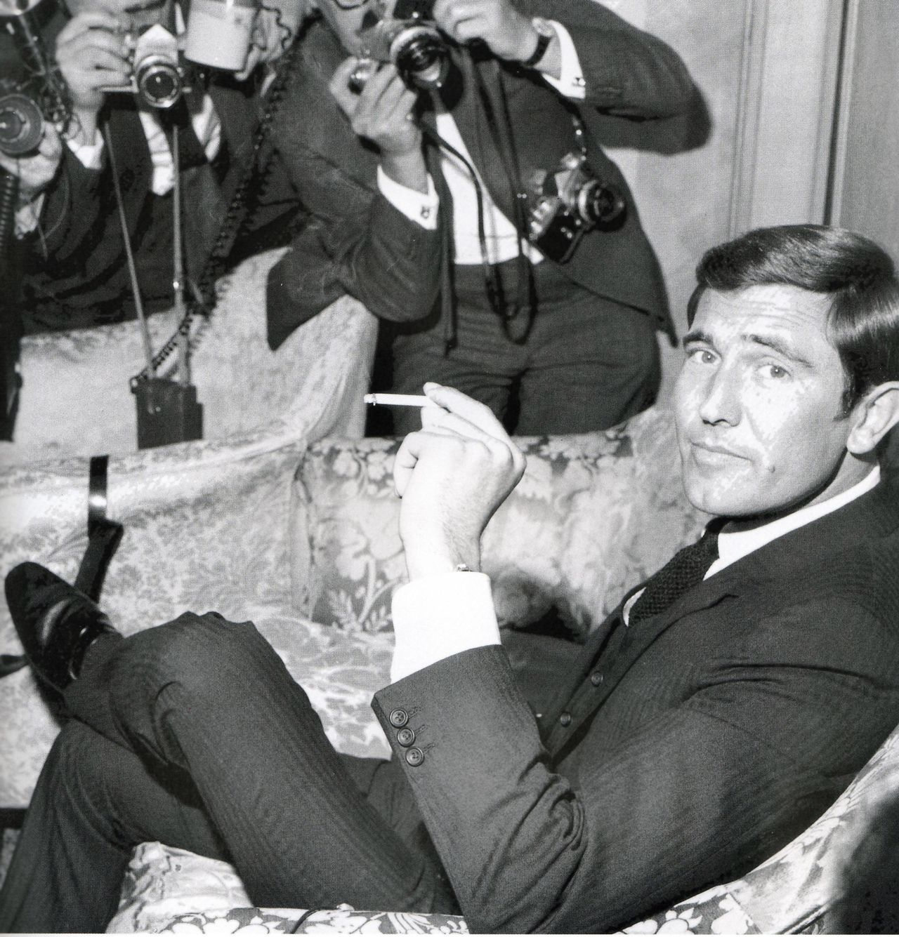 lazenby black and white smoking at the dorchester
