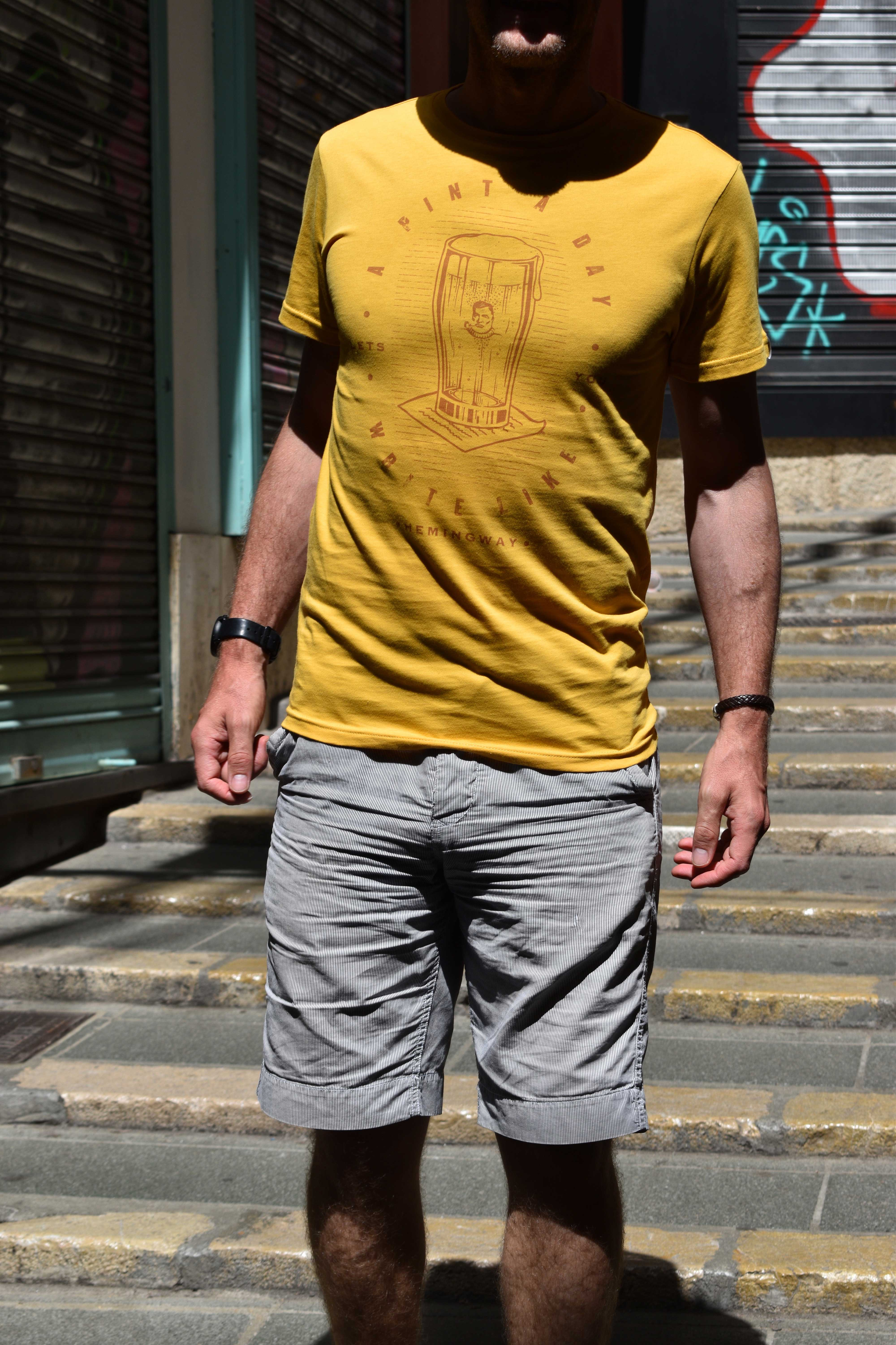 man wearing yellow tee on the steps in palma