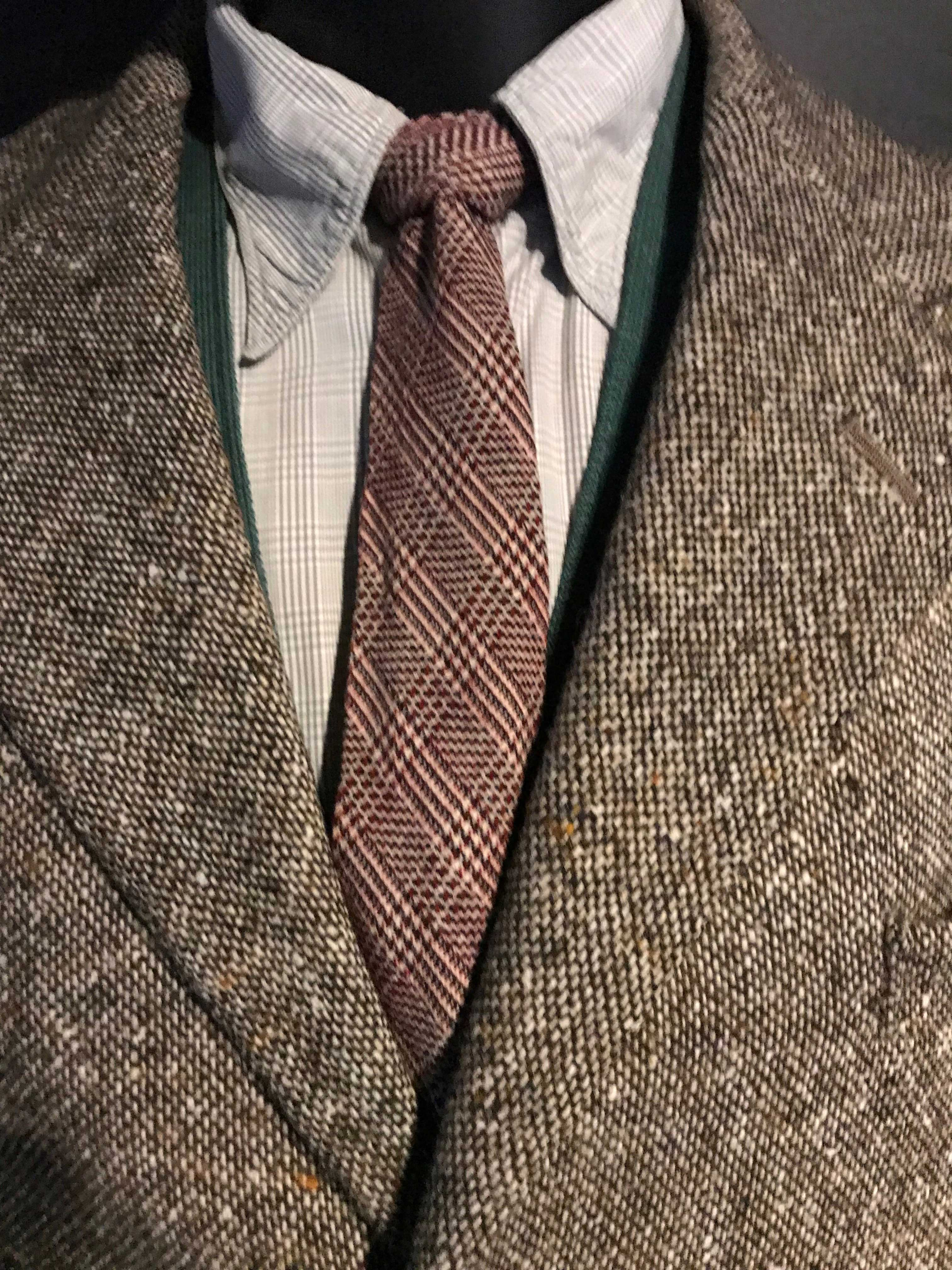 close up of tweed jacket and tie