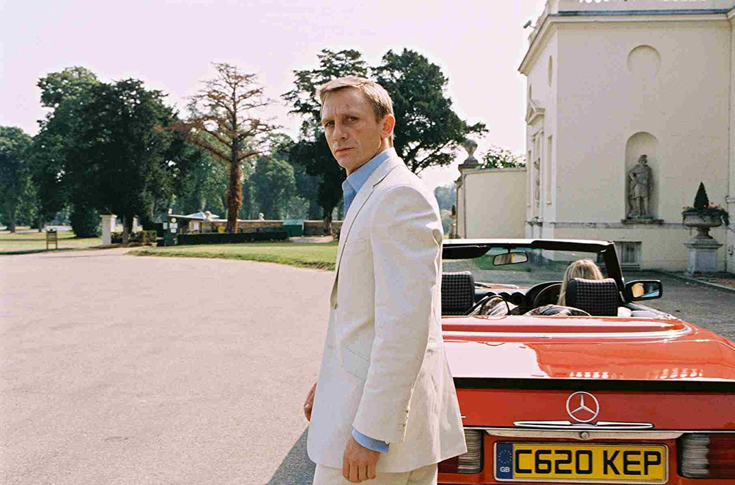 Daniel Craig in Layer Cake Standing by red mercedes