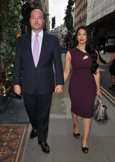 Jonathan Sothcott and Janine Nerissa walking along the street