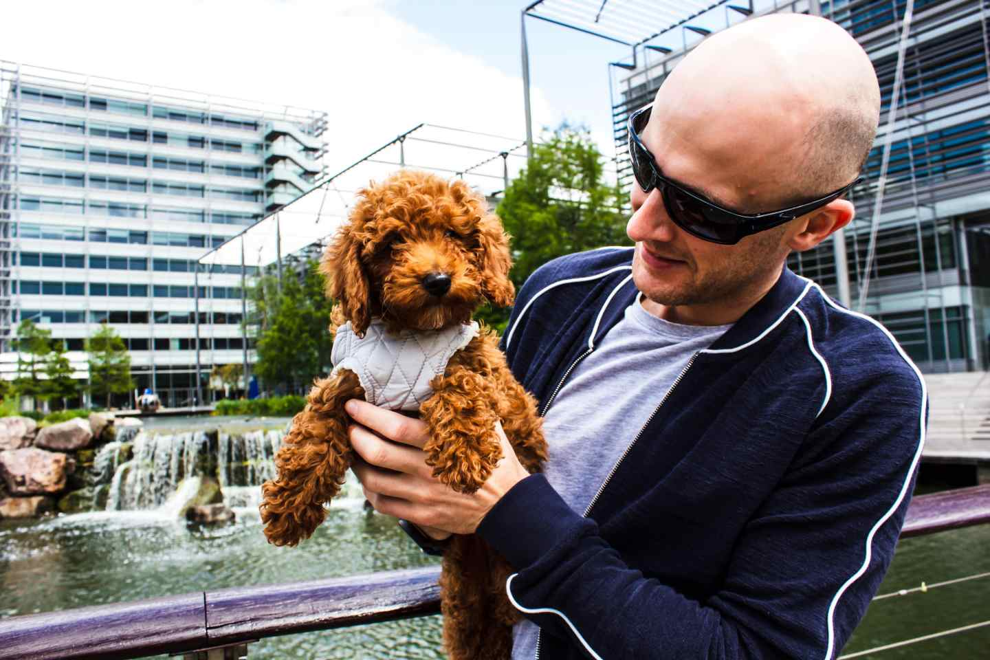 Me wearing my Orlebar Brown jacket holding a puppy