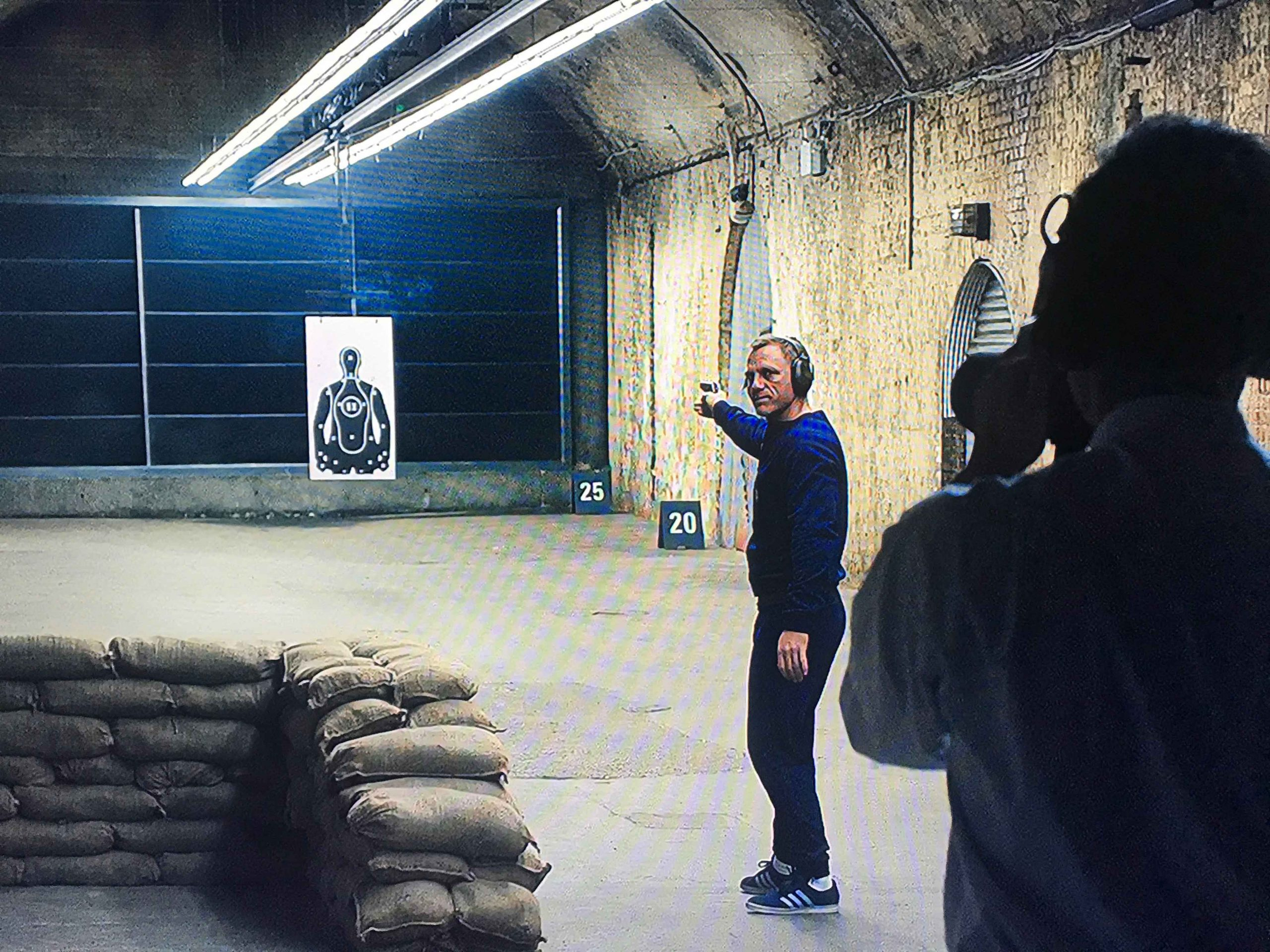 Daniel Craig in Skyfall doing target practice wearing Adidas trainers