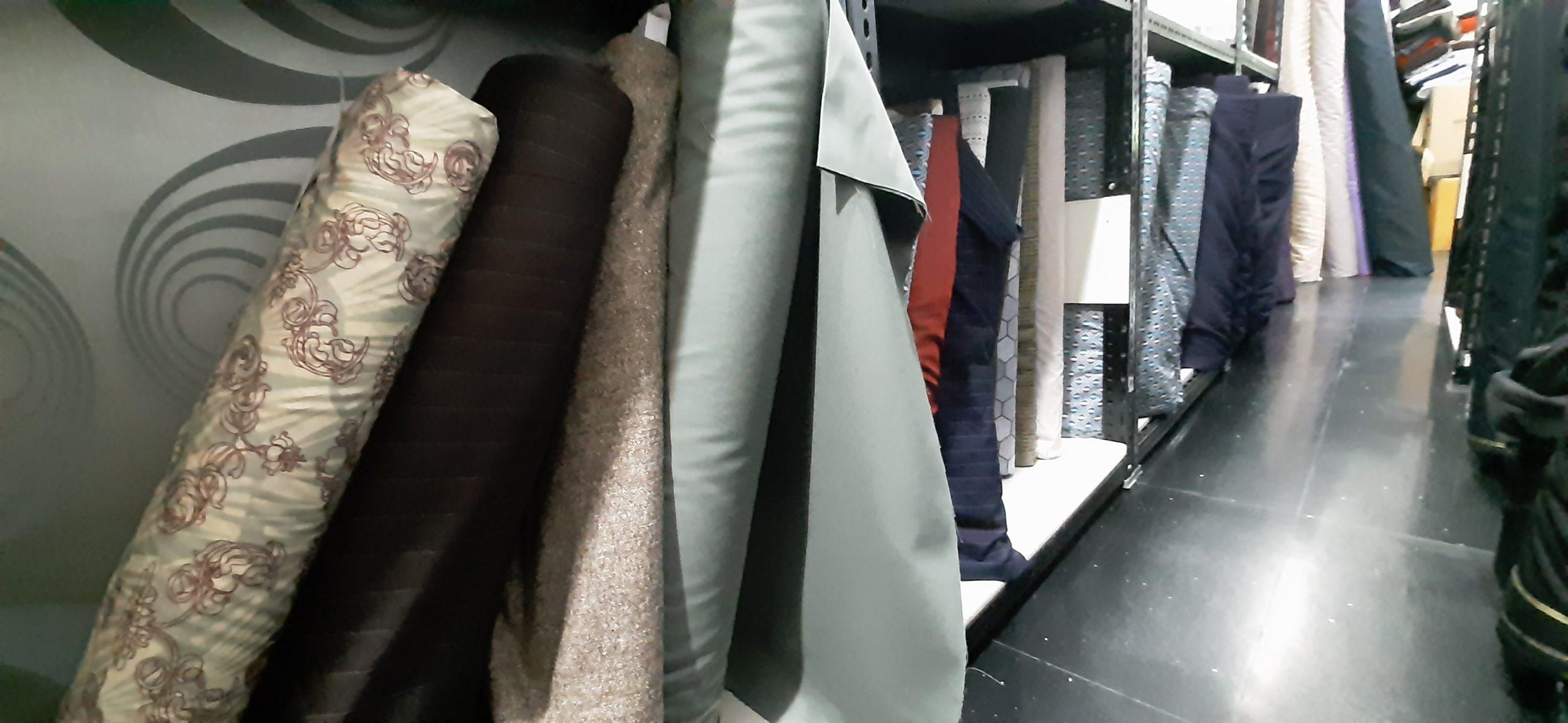 Magnoli Clothiers rolls of fabric