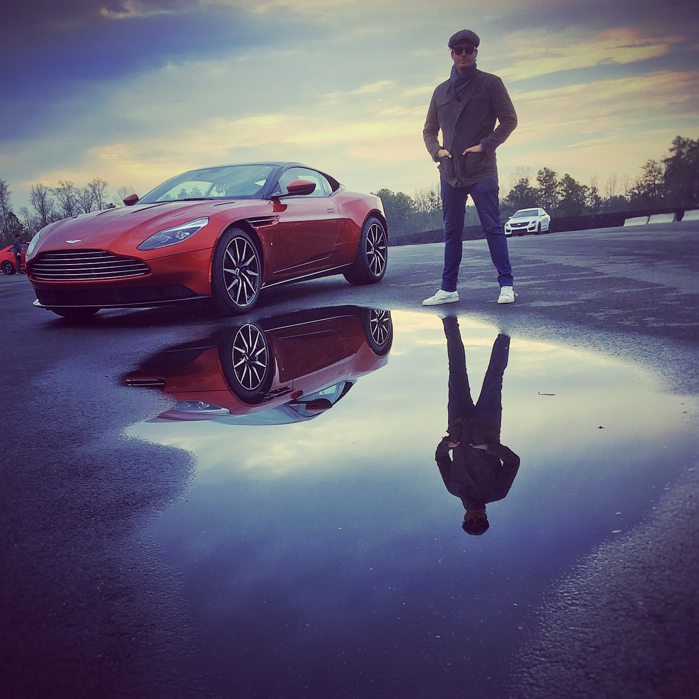 Man standing next to aston martin