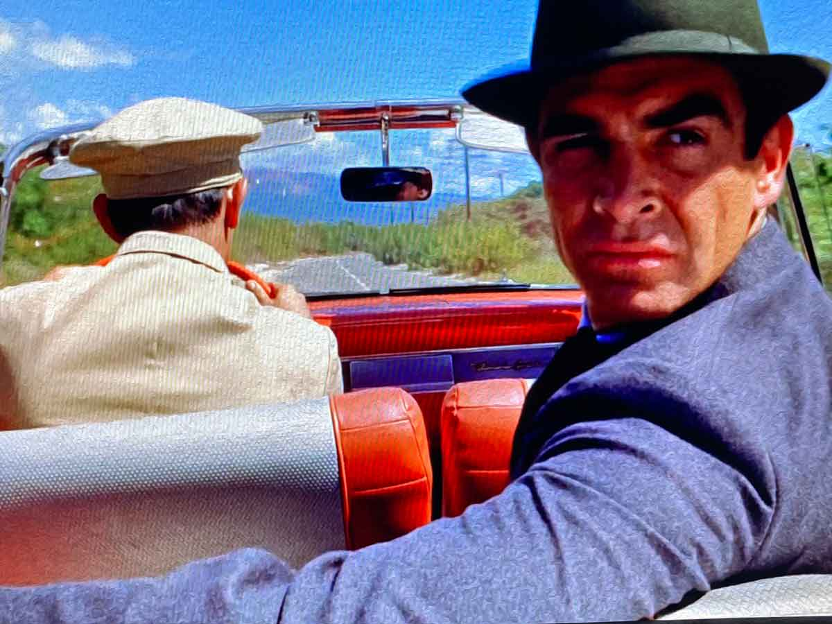 Trilby hat and dark grey flannel suit in Dr No car chase