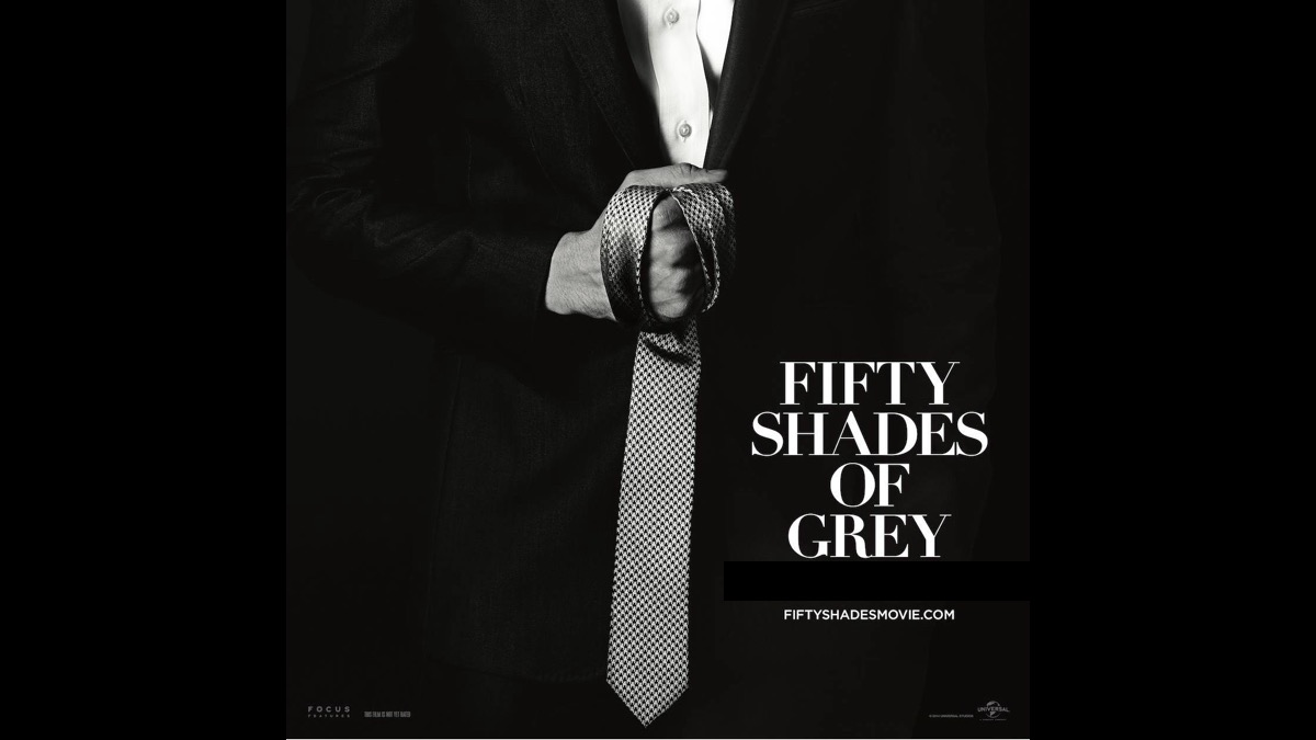 fifty shades of grey movie poster man holding tie