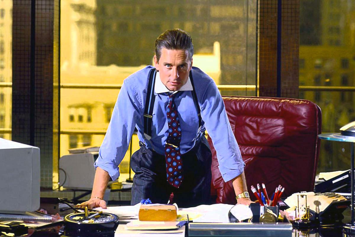 iconic men's ties gordon gekko leaning over desk