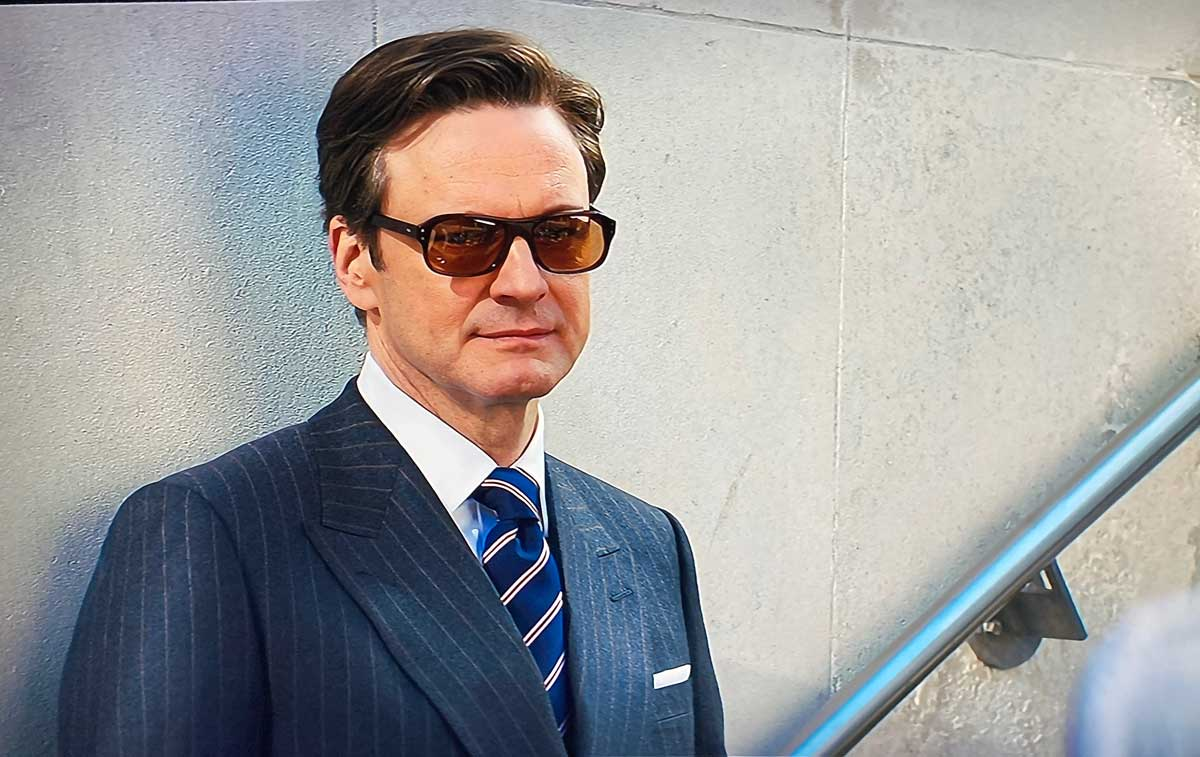 amazing men's ties colin firth in Kingsman leaning against a wall in shades and suit