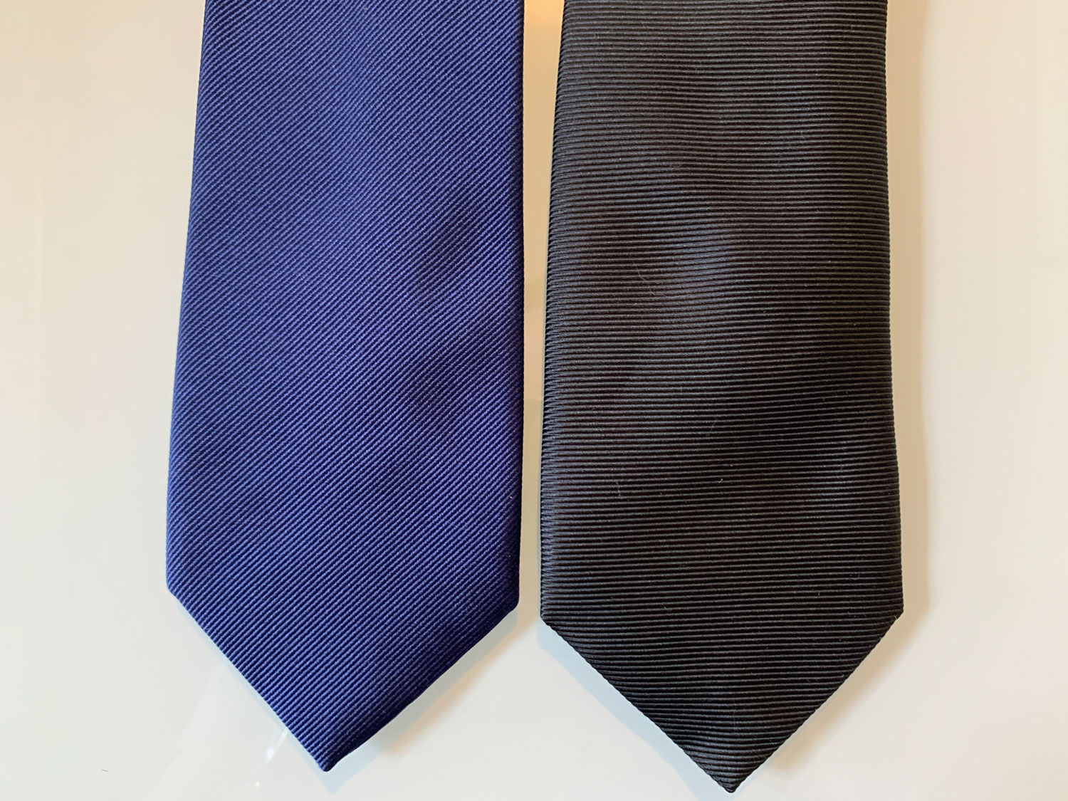 Thomas Pink and Tom ford ties next to each other