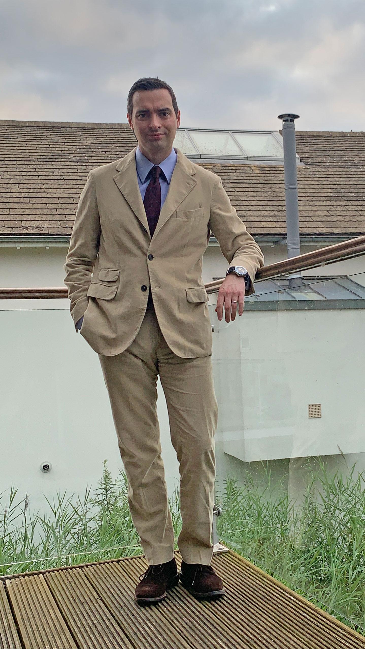 Burgundy Tie worn by Daniel Gaster with the Sloop Suit