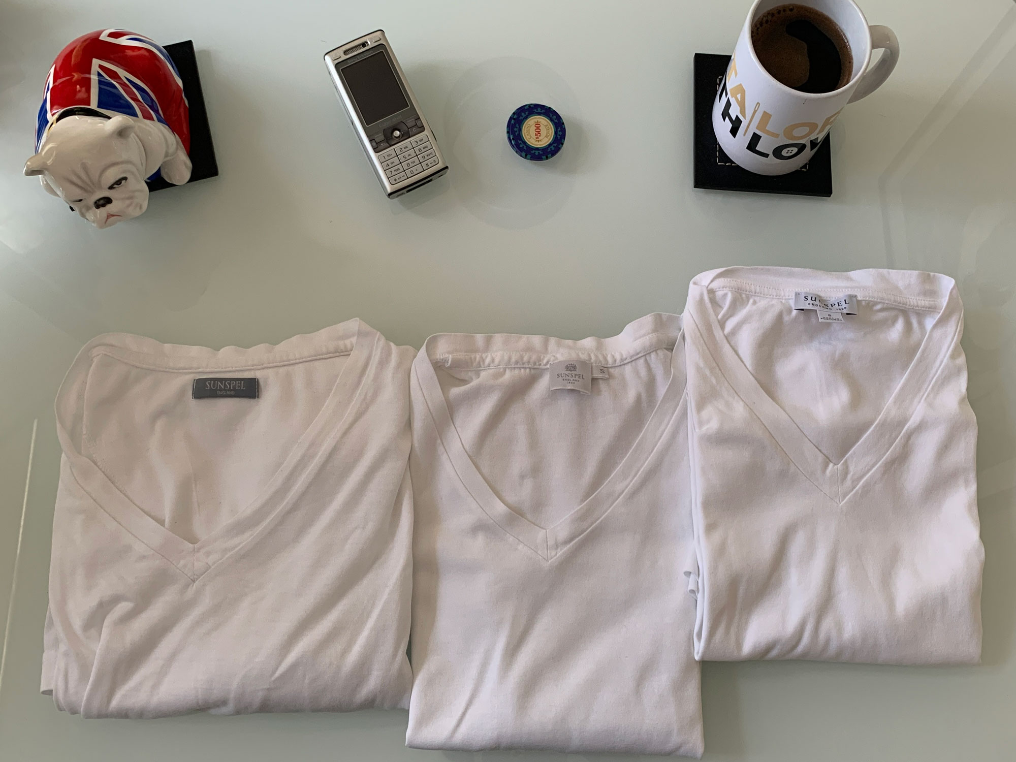 T-Shirts white from Sunspel laid out with props