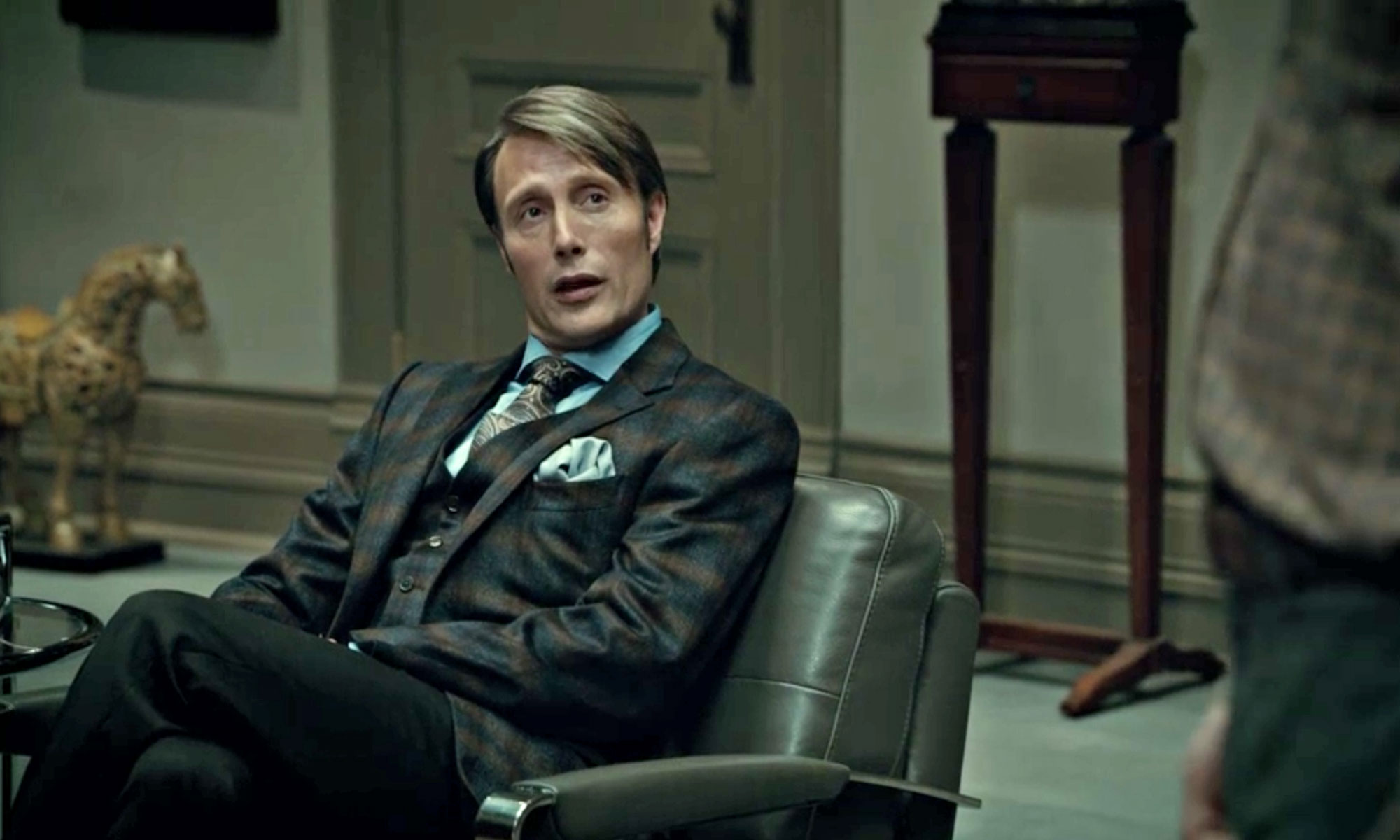 pocket square folds Hannibal sitting down in a three piece