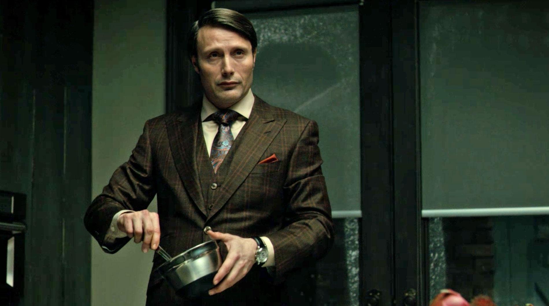 Brown & Green Suit on Hannibal preparing dinner