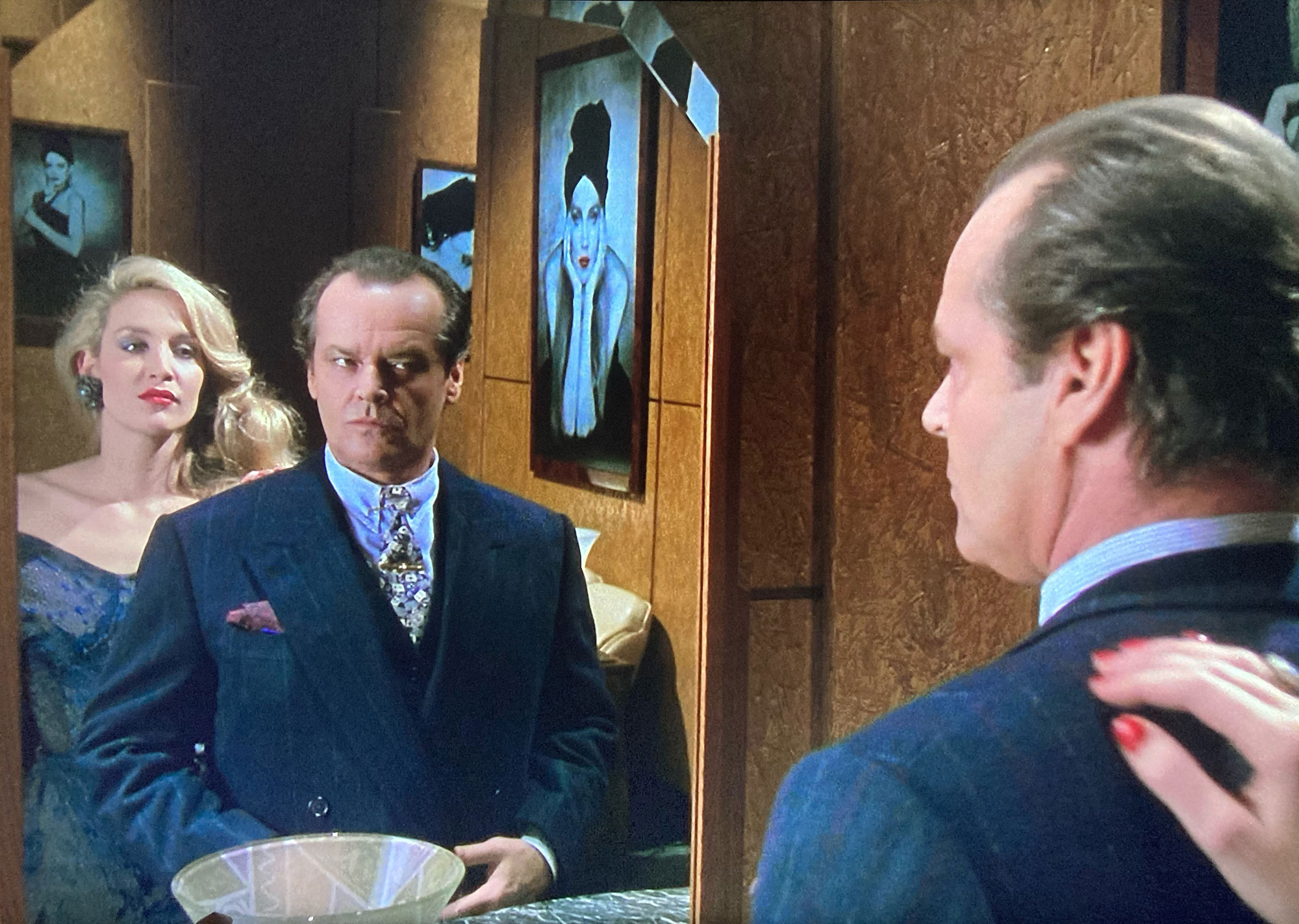 Terry Haste suit photo contains Jack Nicholson looking at Jerry Hall in the mirror