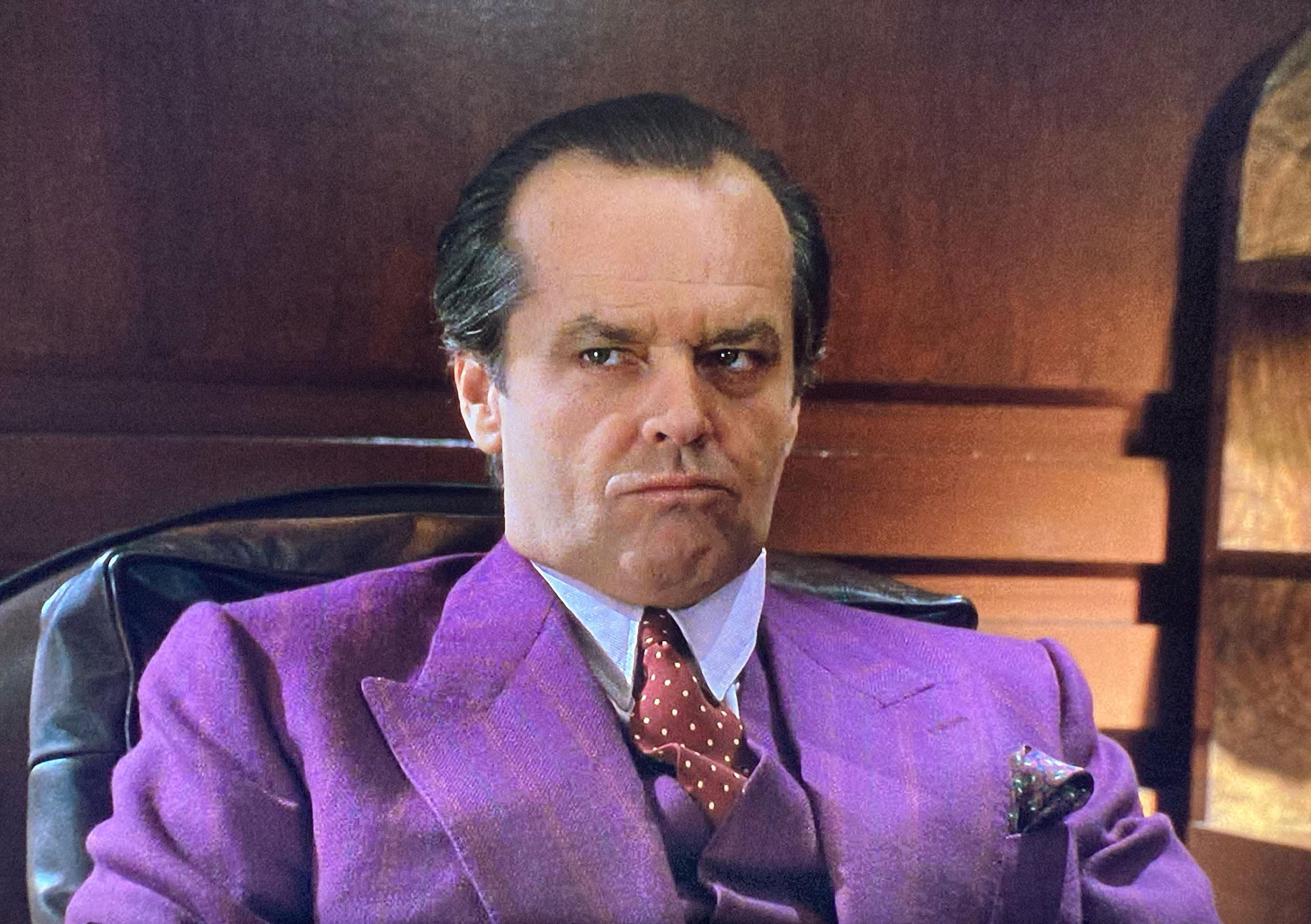 Jack Napier Batman in a purple striped suit cut by Terry Haste