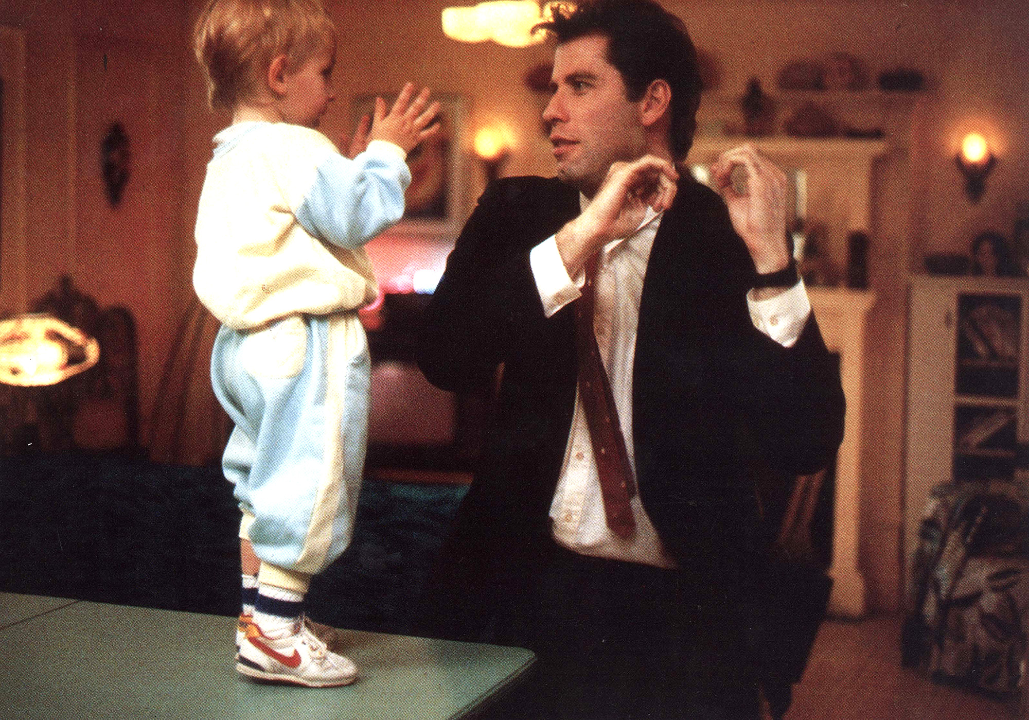 John Travolta in Look Who's Talking, costumes by Molly Maginnis