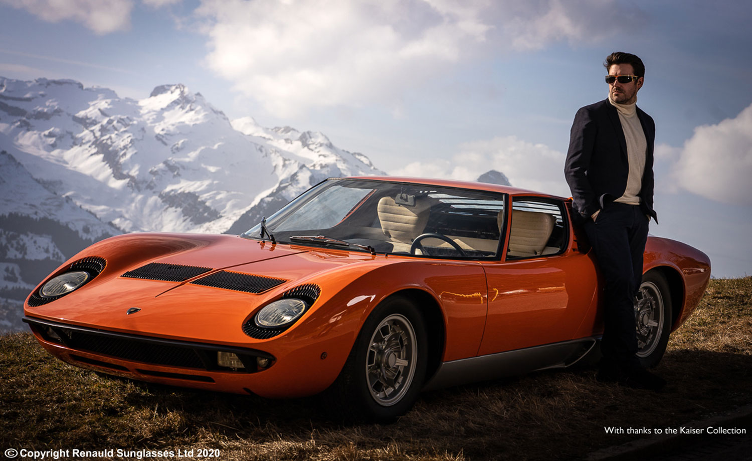 Renauld sunglasses man leaning against classic car looking cool