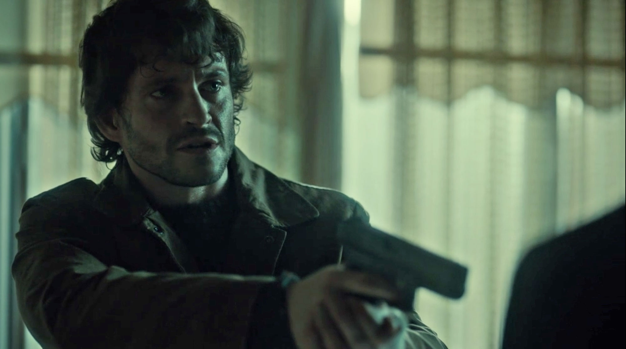 Waxed Cotton Jacket worn by Will Graham pointing a gun